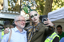 "© Licensed to London News Pictures. 20/09/2019. London, UK. A man with a ""plastic tree"" on his head takes a selfie with Leader of the Labour Party JEREMY CORBYN at the rally attended by tens of thousands of students of all ages take part in climate change global and general strike in Westminster. It is one of more than 150 events planned across the U.K. to demand urgent action to tackle climate change. Photo credit: Dinendra Haria/LNP"