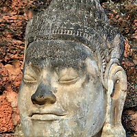 Bayon Style Buddha Statue in Siem Reap, Cambodia<br /> This Buddha portrait in Siem Reap&rsquo;s Old Town is a prelude to what is waiting for you at the Angkor archaeological site. The Bayon style is typical of the late 12th and early 13th centuries religious artwork during the reign of King Jayavarman VII. The sculptures often mixed Buddhist and Hindu elements. An example is the diadem. A variation of this headband was worn by Vishnu as a sign of the deity&rsquo;s supreme power.