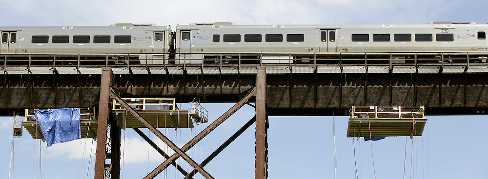 A train crosses the Moodna Viaduct railroad trestle, where Metro North is repairing and repainting steel braces,  in Salisbury Mills. Aug. 24, 2011.