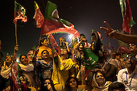 Supporters of Imran Khan, chairman of the Pakistan Tehreek-e-Insaf, cheer and wave party flags during an election campaign rally in Multan, Pakistan, Monday, May 6, 2013. Pakistan is due to hold a general election on May 11, the first transition of power between democratically elected governments.