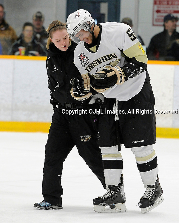 TRENTON, ON - Mar 7 : OJHL North East Conference playoff series round one, Whitby Fury vs Trenton Golden Hawks, Sarah Ditmars (Therapist) of the Trenton Golden Hawks Hockey Club attends to Shaquille Hickey #51 of the Trenton Golden Hawks Hockey Club<br /> (Photo by Amy Deroche / OJHL Images)