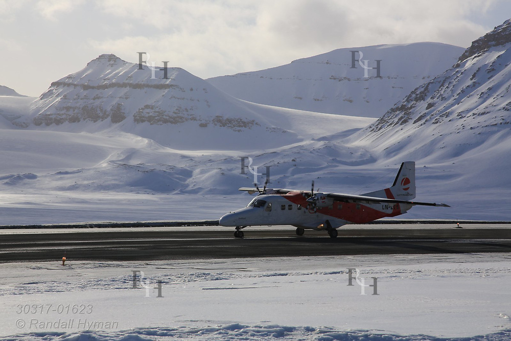 Lufttransport Dornier Do 228 airplane on runway at the Hamnerabben Airport in Ny-Alesund on Spitsbergen island in Kongsfjorden; Svalbard, Norway.