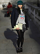 An unidentified guest poses for photographs at Somerset House during London Fashion Week Fall/Winter 2013 in London, Britain, 18 February 2013. The fashion week runs from 15 to 19 February. Flying from New York before travelling to Milan, the fashion industry makes a stop in London to present its Fall/Winter 2013 collections. Over five days models, designers, buyers, bloggers, photographers, makeup artists, hair dressers, celebrities and hipsters congregate at Somerset House for a celebration of cutting edge style. Style is not only reserved to the catwalk. Guests also compete in creativity, often going to extreme lengths to be the coolest cat in town. And London certainly has its fair share of cool cats.