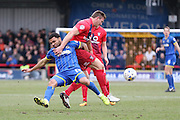 Andy Barcham of AFC Wimbledon and Dave Winfield of York City FC tussle during the Sky Bet League 2 match between AFC Wimbledon and York City at the Cherry Red Records Stadium, Kingston, England on 19 March 2016. Photo by Stuart Butcher.