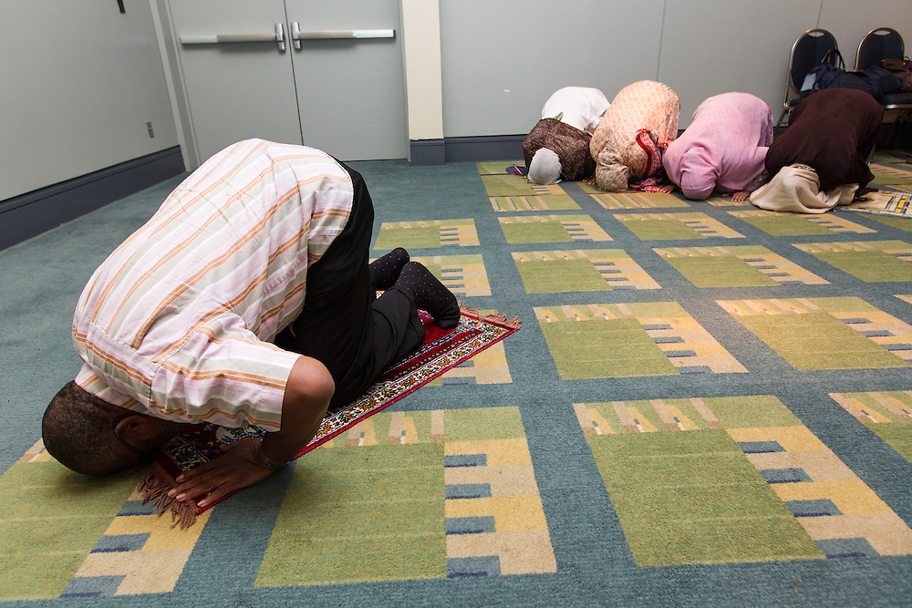 Imam Abdul-Malik Ali bows during Muslim prayers in the 2012 International AIDS Conference interfaith prayer room. (Photo Gregg Brekke/EAA)