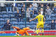 AFC Wimbledon goalkeeper George Long (1), on loan from Sheffield United, and AFC Wimbledon defender Barry Fuller (2) get the ball cleared off the line between them during the EFL Sky Bet League 1 match between Blackburn Rovers and AFC Wimbledon at Ewood Park, Blackburn, England on 16 September 2017. Photo by Simon Davies.