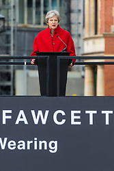 Prime Minister Theresa May addresses the crowd.<br /> A statue designed by Turner Prize-winning artist Gillian Wearing OBE of suffragist leader Millicent Fawcett is unveiled in Parliament Square by XXXX. The sculpture is the first-ever monument to a woman and the first designed by a woman to stand within the square and follows the successful campaign by feminist campaigner Caroline Criado-Perez who organised an 85,000 signature petition. London, April 24 2018.