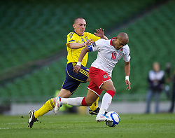 DUBLIN, REPUBLIC OF IRELAND - Wednesday, May 25, 2011: Wales' captain Robert Earnshaw and Scotland's Scott Brown during the Carling Nations Cup match at the Aviva Stadium (Lansdowne Road). (Photo by David Rawcliffe/Propaganda)