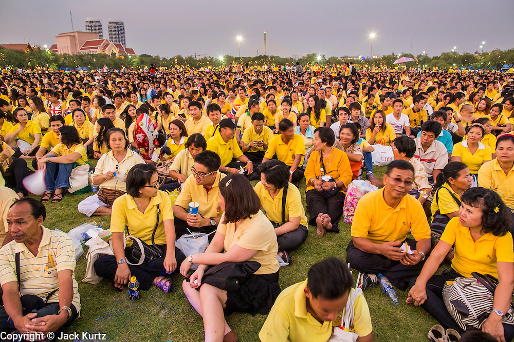 05 DECEMBER 2012 - BANGKOK, THAILAND: Thais gather at Sanam Luang during the public ceremony to celebrate the birthday of Bhumibol Adulyadej, the King of Thailand, on Sanam Luang, a vast public space in front of the Grand Palace in Bangkok Wednesday night. The King celebrated his 85th birthday Wednesday and hundreds of thousands of Thais attended the day long celebration around the Grand Palace and the Royal Plaza, north of the Palace. The Thai monarch is revered by most Thais as unifying force in Thailand's society, which is not yet recovered from the political violence of 2010.      PHOTO BY JACK KURTZ