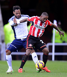 Sunderland's Jermain Defoe competes with West Bromwich Albion's Joleon Lescott - Photo mandatory by-line: Richard Martin-Roberts/JMP - Mobile: 07966 386802 - 21/02/2015 - SPORT - Football - Sunderland - Stadium of Light - Sunderland v West Bromwich Albion - Barclays Premier League