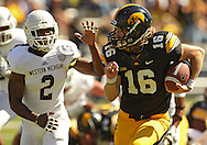 September 21 2013: Iowa Hawkeyes quarterback C.J. Beathard (16) tries to get away from Western Michigan Broncos safety Demetrius Pettway (2) during the fourth quarter of the NCAA football game between the Western Michigan Broncos and the Iowa Hawkeyes at Kinnick Stadium in Iowa City, Iowa on September 21, 2013. Iowa defeated Western Michigan 59-3.