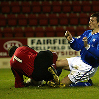 St Johnstone v Ross County....06.12.03<br />Chris Hay collides with Colin Stewart which resulted in the keeper being stretchered off<br />Picture by Graeme Hart.<br />Copyright Perthshire Picture Agency<br />Tel: 01738 623350  Mobile: 07990 594431