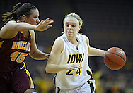 February 18, 2010: Iowa guard Jaime Printy (24) tries to drive around Minnesota forward Jackie Voigt (45) during the second half of the NCAA women's basketball game at Carver-Hawkeye Arena in Iowa City, Iowa on February 18, 2010. Iowa defeated Minnesota 75-54.