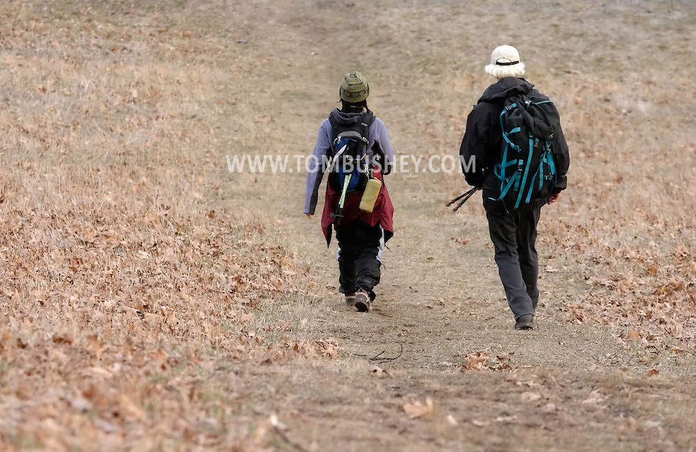 Mountainville, N.Y. - A man and a woman walk back to the trail head after hiking on Schunnemunk Mountain on Feb. 25, 2006.