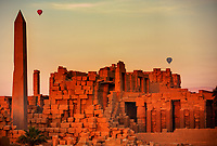 Hot-air ballooning over the Karnak temple at sunset with the Obelisk in luxor upper egypt