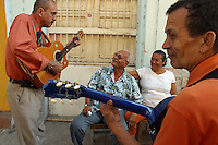 """Musicians play on the street in the """"Old City"""" in Cartagena, a unique travel destination on Colombia's Caribbean coast. (Photo/Scott Dalton)"""