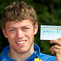 Murray Davidson with St Johnstone Season Ticket for 2011-12<br /> Picture by Graeme Hart.<br /> Copyright Perthshire Picture Agency<br /> Tel: 01738 623350  Mobile: 07990 594431