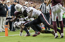 South Carolina linebacker T.J. Brunson (6) and D.J. Smith (24) stop Texas A&M running back Trayveon Williams (5) just short of the goal line during the first quarter of an NCAA college football game Saturday, Sept. 30, 2017, in College Station, Texas. (AP Photo/Sam Craft)