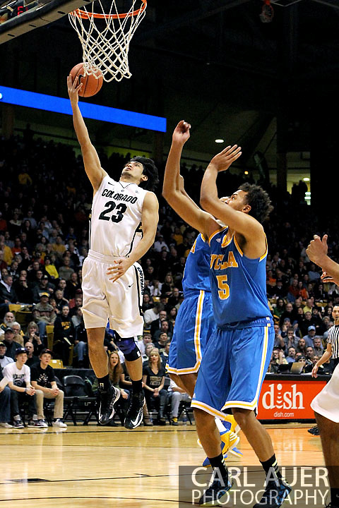 January 12th, 2013: Colorado Buffaloes senior guard Sabatino Chen (23) slices past the UCLA defense for an easy lay up in the first half of the NCAA basketball game between the UCLA Bruins and the University of Colorado Buffaloes at the Coors Events Center in Boulder CO