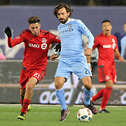 NEW YORK, NEW YORK - November 06: Andrea Pirlo #21 of New York City FC is challenged by Jonathan Osorio #21 of Toronto FC during the NYCFC Vs Toronto FC MLS playoff game at Yankee Stadium on November 06, 2016 in New York City. (Photo by Tim Clayton/Corbis via Getty Images)