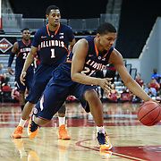 Malcolm Hill #21 of the Illinois Fighting Illini reaches for a loose ball during the NIT First Round game at Agganis Arena on March 19, 2014 in Boston, Massachusetts . (Photo by Elan Kawesch)
