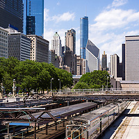 Photo of Chicago skyline city office buildings and Van Buren Street Metra Train Station in the downtown Chicago Loop including Trump Tower and Crain Communications Building (formerly Smurfit-Stone Building) Photo is vertical, high resolution and was taken in 2012.