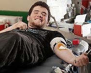 Amiel Maerling of Greenfield Park smiles while donating blood at Sullivan County Community College in Loch Sheldrake on Tuesday, Feb. 8, 2011.