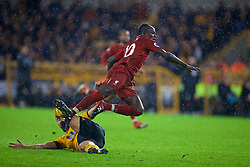 WOLVERHAMPTON, ENGLAND - Friday, December 21, 2018: Liverpool's Sadio Mane is tackled by Wolverhampton Wanderers' Romain Saïss during the FA Premier League match between Wolverhampton Wanderers FC and Liverpool FC at Molineux Stadium. (Pic by David Rawcliffe/Propaganda)