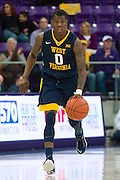 FORT WORTH, TX - JANUARY 4: Teyvon Myers #0 of the West Virginia Mountaineers brings the ball up court against the TCU Horned Frogs on January 4, 2016 at Ed and Ray Schollmaier Arena in Fort Worth, Texas.  (Photo by Cooper Neill/Getty Images) *** Local Caption *** Teyvon Myers