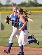 Washington's Caitlan Peterson (3) celebrates with Hannah Schroeder (6) after the third out of the inning during the softball game between Cedar Rapids Washington and Linn-Mar at Oak Ridge Middle School in Marion on Thursday, June 20, 2013. The Lions defeated the Warriors 7-6 in 9 innings.