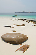 Stones and boat in the beach at   Chapera Island. Las Perlas archipelago, Panama province, Panama, Central America.