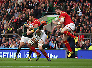 South Africa's Schalk Burger making a flying tackle on Wales Taulupe Faletau during the Rugby World Cup Quarter Final match between South Africa and Wales at Twickenham, Richmond, United Kingdom on 17 October 2015. Photo by Matthew Redman.