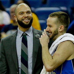 Jan 6, 2016; New Orleans, LA, USA; Dallas Mavericks guard Deron Williams (left) and guard J.J. Barea (5) talk on the bench during the second half of a game against the New Orleans Pelicans at the Smoothie King Center. The Mavericks defeated the Pelicans 100-91. Mandatory Credit: Derick E. Hingle-USA TODAY Sports