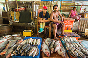 13 JUNE 2013 - YANGON, MYANMAR: Fish sellers in the Annawa Fish Market. The Annawa Fish Market in Yangon is one of the largest fish markets in Myanmar. It serves as both a wholesale and retail market and serves both exporters and domestic customers. With thousands of miles of riverine waterways and ocean coastline Myanmar has a large seafood and fishing industry.    PHOTO BY JACK KURTZ
