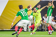 Alejandro Guerra of Venezuela, center, dribbles the ball among Mexican defenders during a Copa America Centenario group stage match played at NRG Stadium in Houston,Texas, on Monday June 13, 2016.