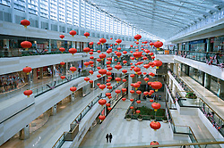 Interior of large modern luxury shopping mall in central Beijing China