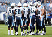 The Tennessee Titans huddle before the NFL week 6 regular season football game against the Jacksonville Jaguars on Sunday, Oct. 12, 2014 in Nashville, Tenn. The Titans won the game 16-14. ©Paul Anthony Spinelli