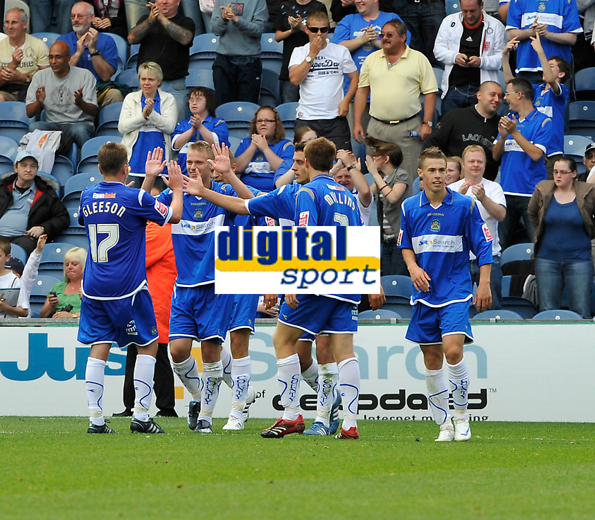 Stockport County's Peter Thompson (2nd Left) is congratulated by team mates after scoring the second Stockport goal.<br />