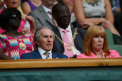 © Licensed to London News Pictures. 23/06/2014. Wimbledon, UK Sir Jackie Stewart watches Djokovic v Golubev  in the 1st round at the Wimbledon Tennis Championships 23rd June 2014. Photo credit : Mike King/LNP