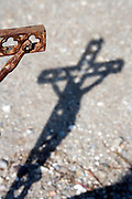 hand of Jesus on the cross with the shadow of the whole cross