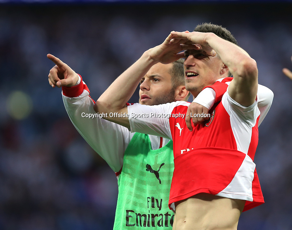 18 April 2015  FA Cup semi-final - Arsenal v Reading;  Jack Wilshere helps Laurent Koscielny to find his friends or family in the Wembley stand.<br /> Photo: Mark Leech