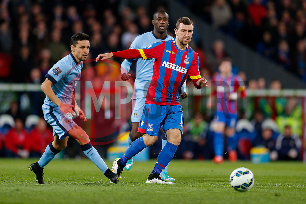 James McArthur of Crystal Palace is challenged by Jesus Navas of Manchester City - Photo mandatory by-line: Rogan Thomson/JMP - 07966 386802 - 06/04/2015 - SPORT - FOOTBALL - London, England - Selhurst Park - Crystal Palace v Manchester City - Barclays Premier League.