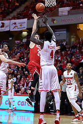 "11 February 2017:  Jayden Hodgson shoots over Daouda ""David"" Ndiaye (4) during a College MVC (Missouri Valley conference) mens basketball game between the Bradley Braves and Illinois State Redbirds in  Redbird Arena, Normal IL"