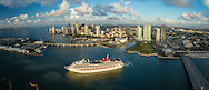 Carnival Cruise Line ship in the Miami turning basin at dawn from the air.