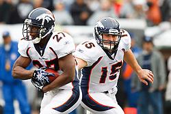 December 19, 2010; Oakland, CA, USA;  Denver Broncos quarterback Tim Tebow (15) hands off to running back Knowshon Moreno (27) during the first quarter against the Oakland Raiders at Oakland-Alameda County Coliseum.