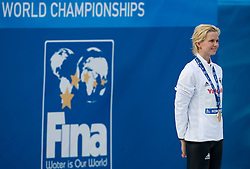 Winner Britta Steffen of Germany  at the victory ceremony after the Women's  50m Freestyle Final during the 13th FINA World Championships Roma 2009, on August 2, 2009, at the Stadio del Nuoto,  in Foro Italico, Rome, Italy. (Photo by Vid Ponikvar / Sportida)
