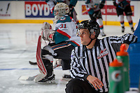 KELOWNA, CANADA - DECEMBER 30: Linesman, Dustin Minty, stretches on the ice during warm up on December 30, 2016 at Prospera Place in Kelowna, British Columbia, Canada.  (Photo by Marissa Baecker/Shoot the Breeze)  *** Local Caption ***