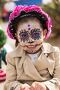 A young girl dressed as a skeleton during the Day of the Dead Festival known in spanish as Día de Muertos October 31, 2014 in Oaxaca, Mexico.