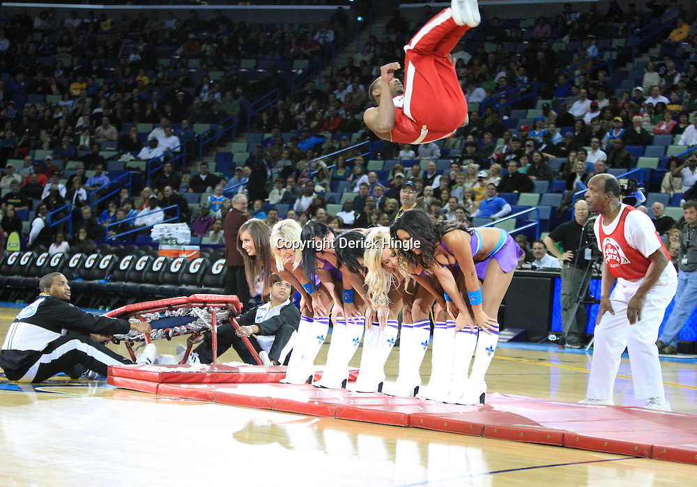 04 February 2009:  The Jesse White Tumblers perform a jump over the Hornets Honeybee cheerleaders during halftime of a 93-107 loss by the New Orleans Hornets to the Chicago Bulls at the New Orleans Arena in New Orleans, LA.