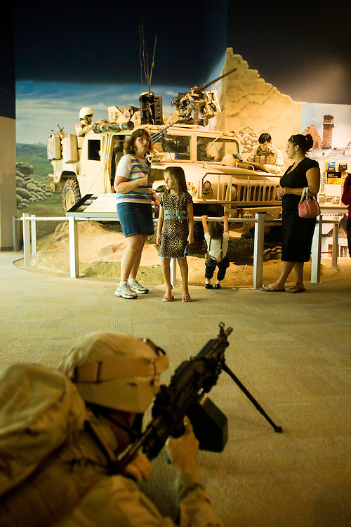Melanie Gee, far right, views an exhibit depicting United States Army soldiers in Iraq with her daughters, Maize and Jillian, and mother, Retired Air Force Chief Fran Defazio, inside the Airborne & Special Operations Museum in Fayetteville, NC, Sat., Nov. 15, 2008. Gee?s husband, Ken, is on active duty with the 82nd Airborne and has been deployed to Iraq and Afghanistan for three tours. .